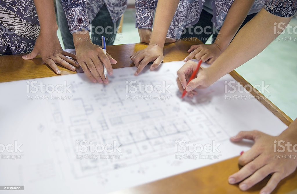 Architect discuss building plan stock photo