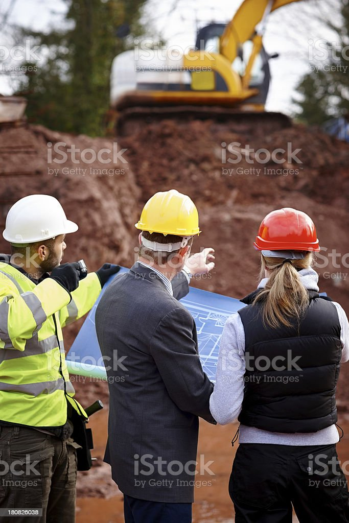 Architect discussing development with contractors royalty-free stock photo