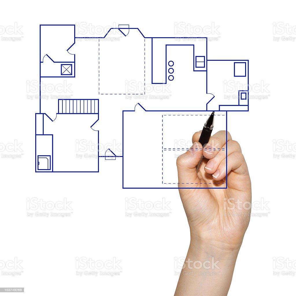 architect drafting a house blueprint royalty-free stock photo
