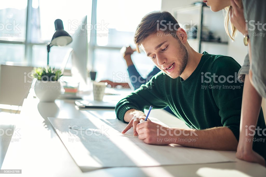 Architect drawing a plan stock photo