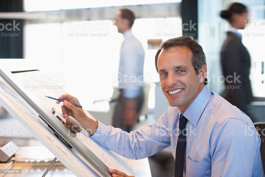 Architect drawing blueprint in office royalty-free stock photo
