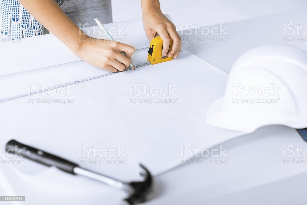 architect drawing on blueprint royalty-free stock photo