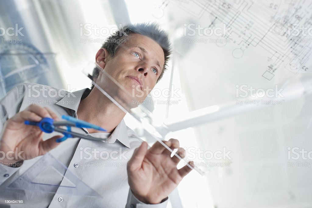 Architect drawing on glass table royalty-free stock photo