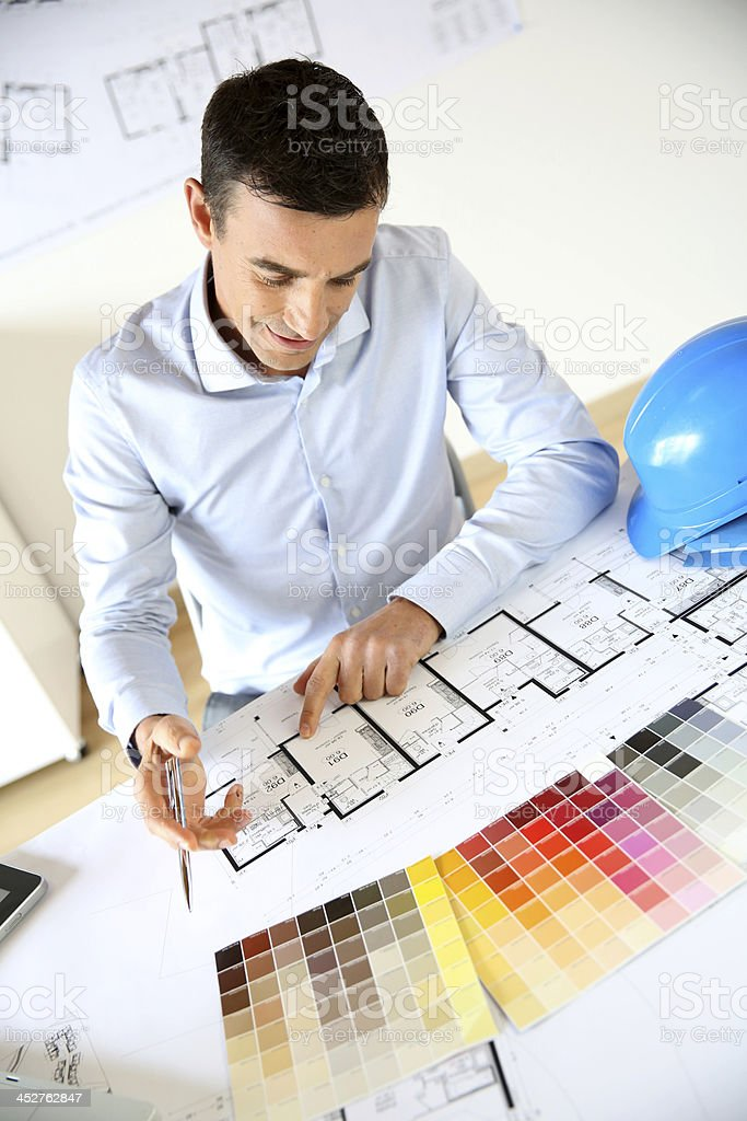 Architect drawing plan in office royalty-free stock photo