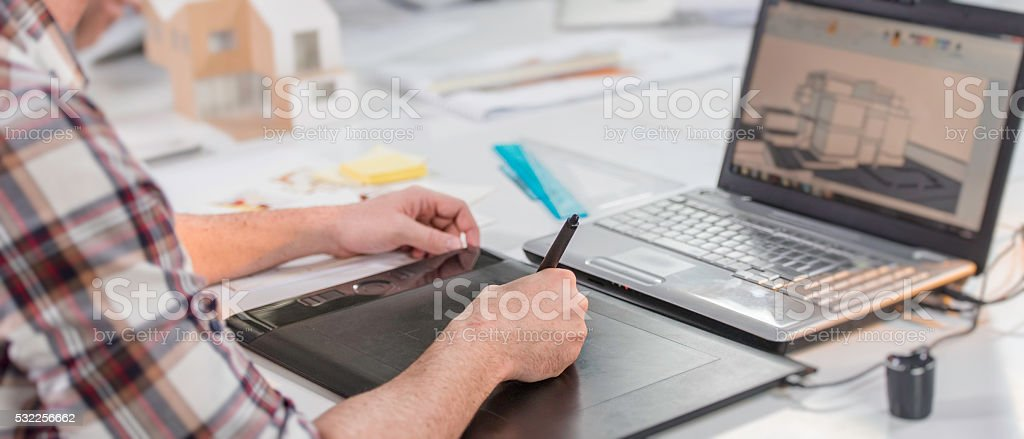 Architect drawing plans with a graphics tablet stock photo