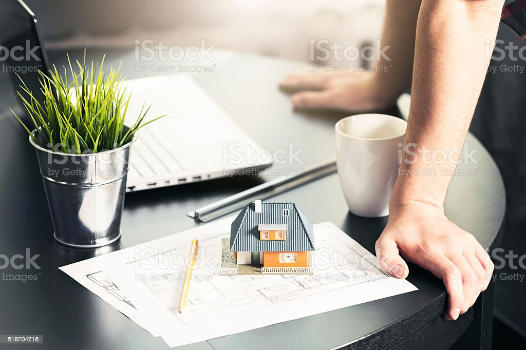 architect, engineer occupation - man working on new house project stock photo
