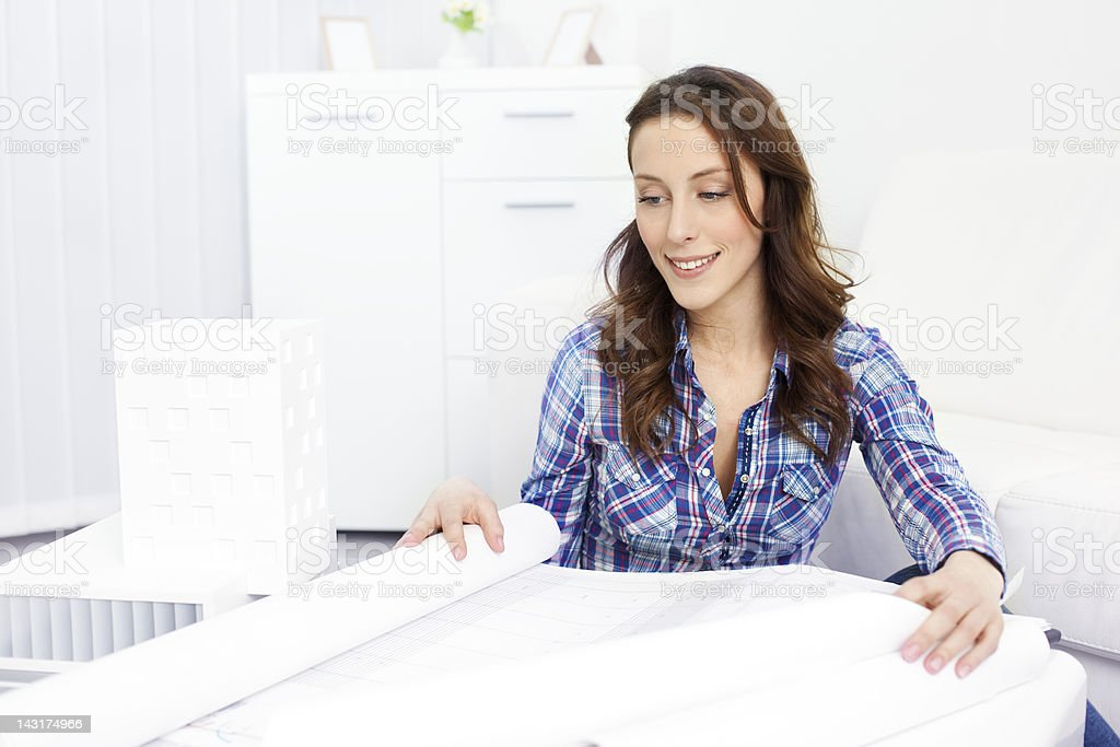 Architect Examining Blueprints. royalty-free stock photo