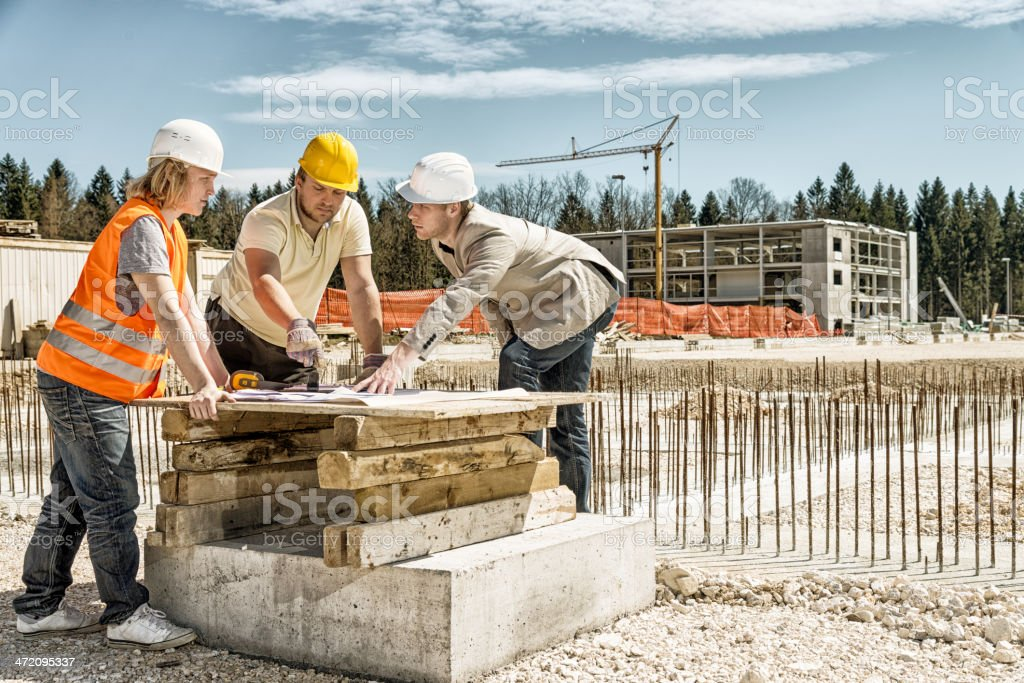 Architect explaining blueprints stock photo