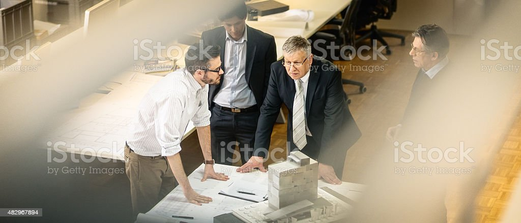 Architect explaining project plan to clients stock photo