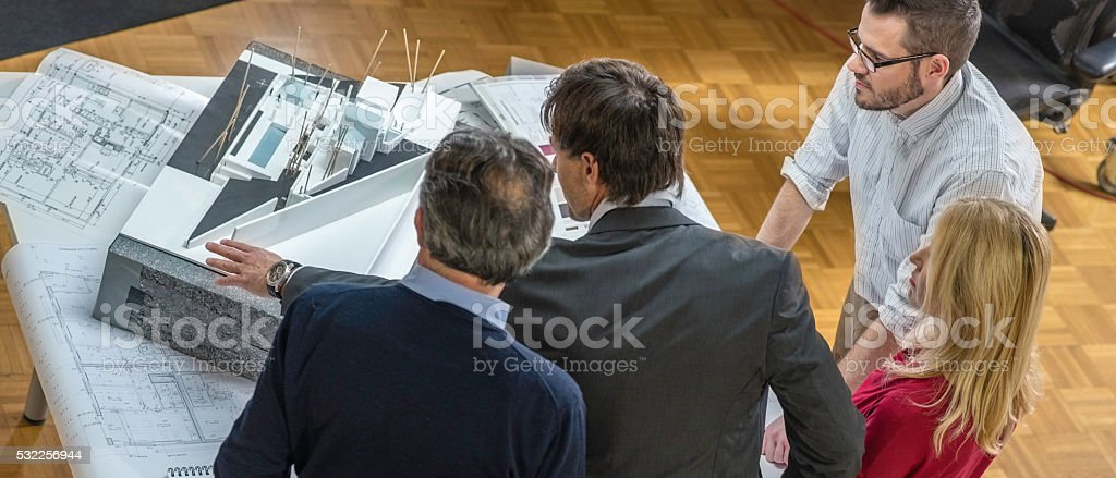 Architect explaining project plan to customers stock photo