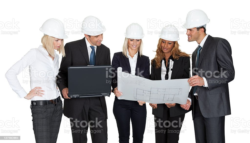 Architect group analyzing blueprints royalty-free stock photo