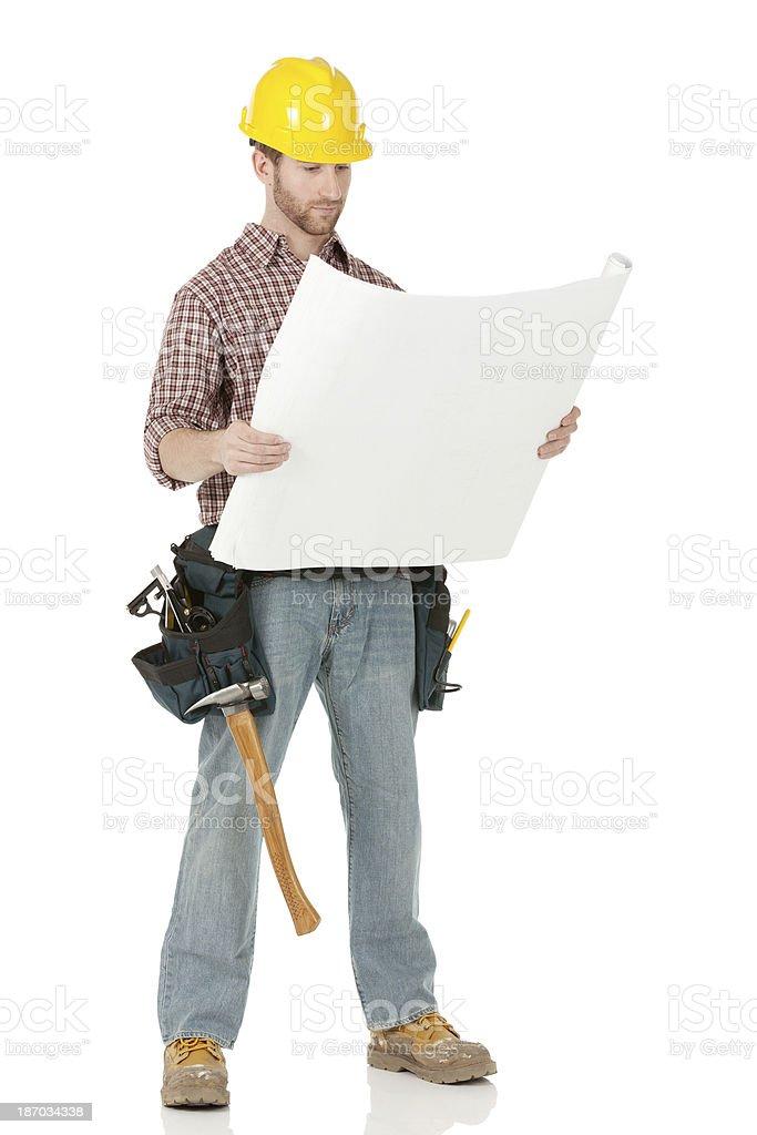 Architect holding a blueprint royalty-free stock photo