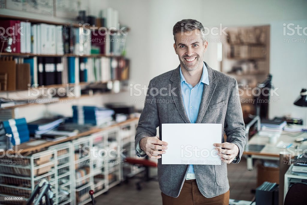 Architect  holding blank board stock photo