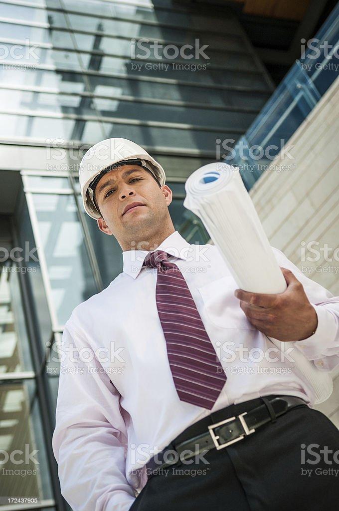 Architect holding blueprint royalty-free stock photo