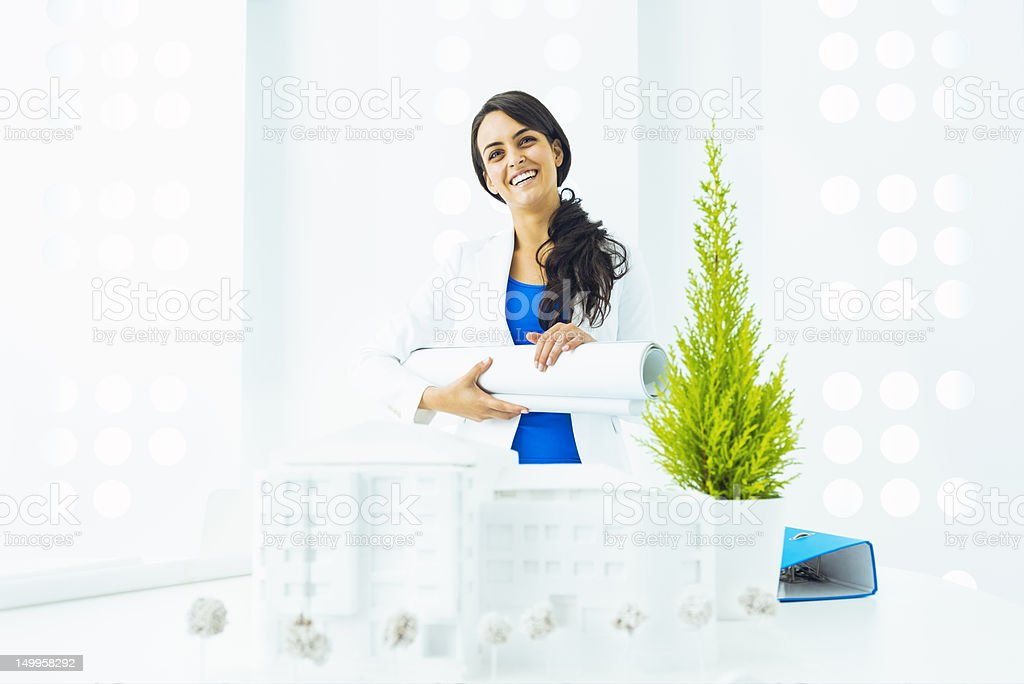Architect holding blueprints in a contemporary office royalty-free stock photo