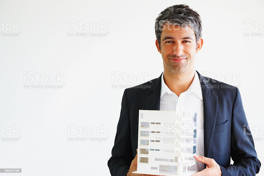 Architect holding model of a building over white royalty-free stock photo