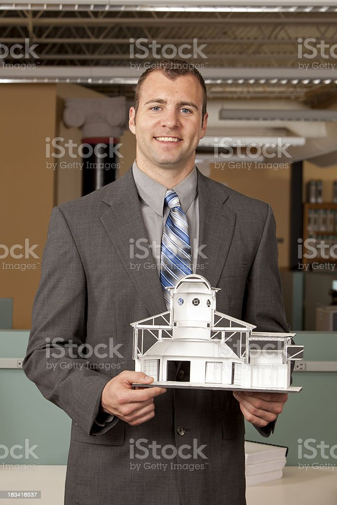 Architect holding model royalty-free stock photo