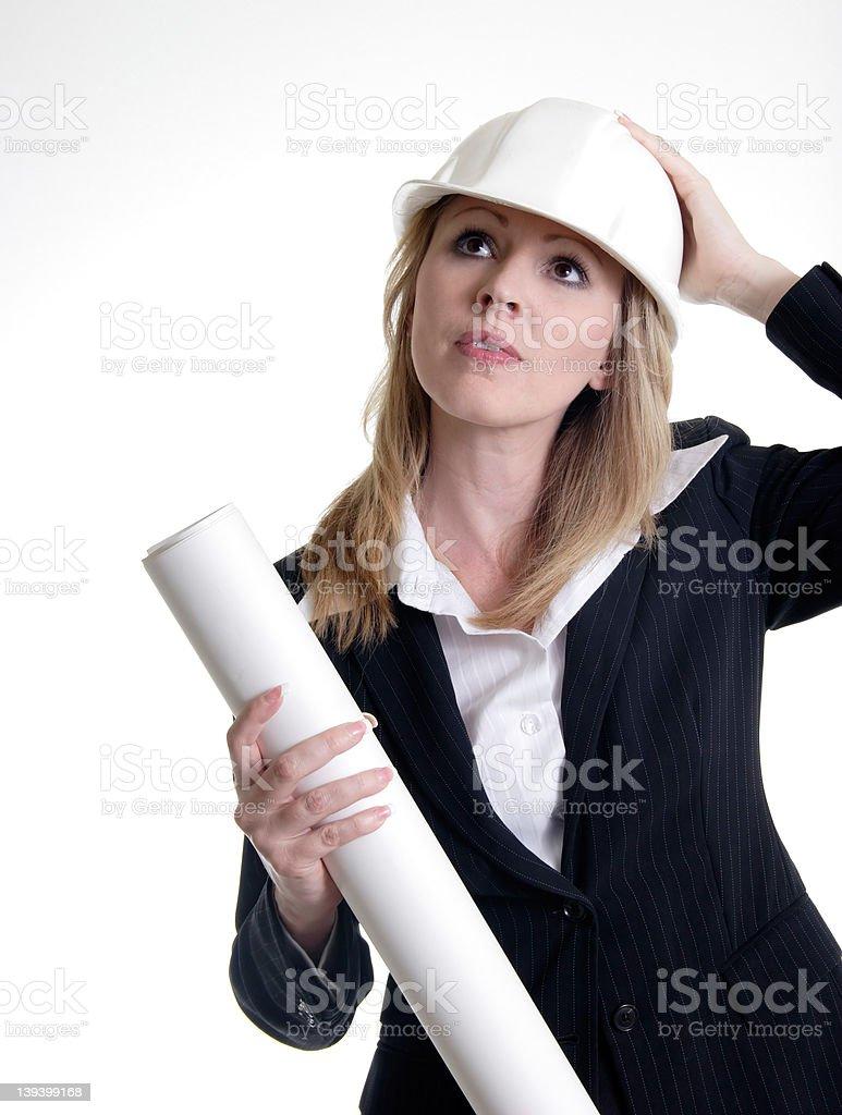 Architect holding on to hard hat royalty-free stock photo