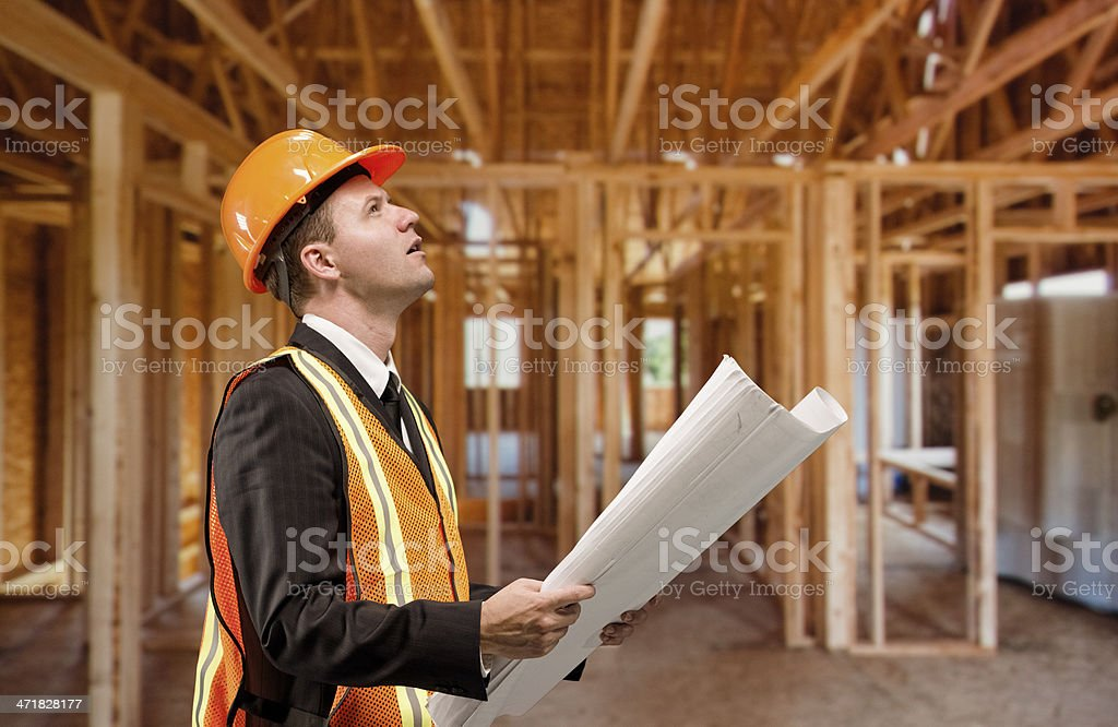 Architect in an under construction house royalty-free stock photo