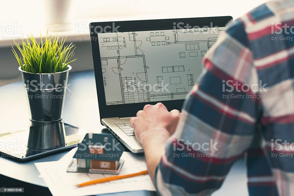 architect, interior designer occupation - man working on house project stock photo