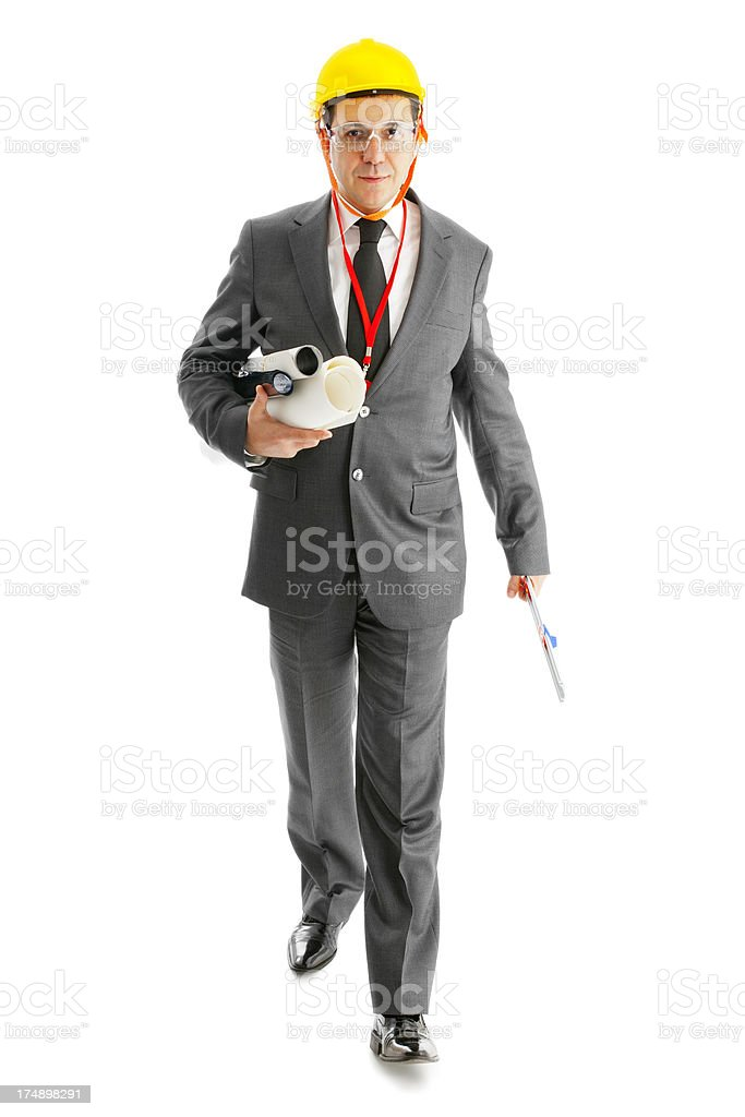Architect is walking and holding some blueprint , ruler royalty-free stock photo