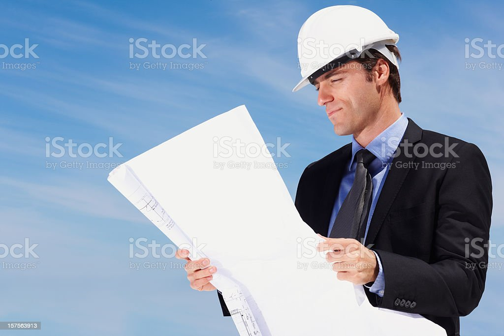 Architect looking at a new construction plan royalty-free stock photo