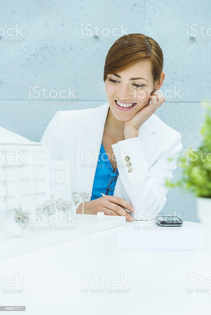 Architect looking at building model with satisfaction. royalty-free stock photo