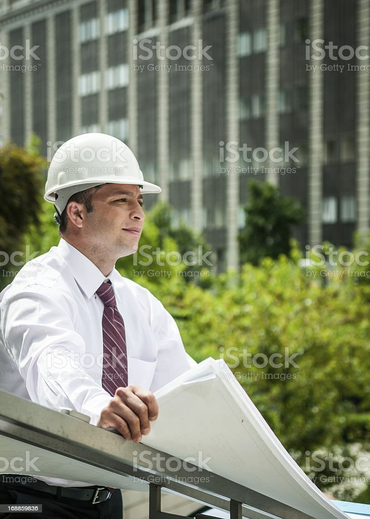 Architect looking at building plans royalty-free stock photo