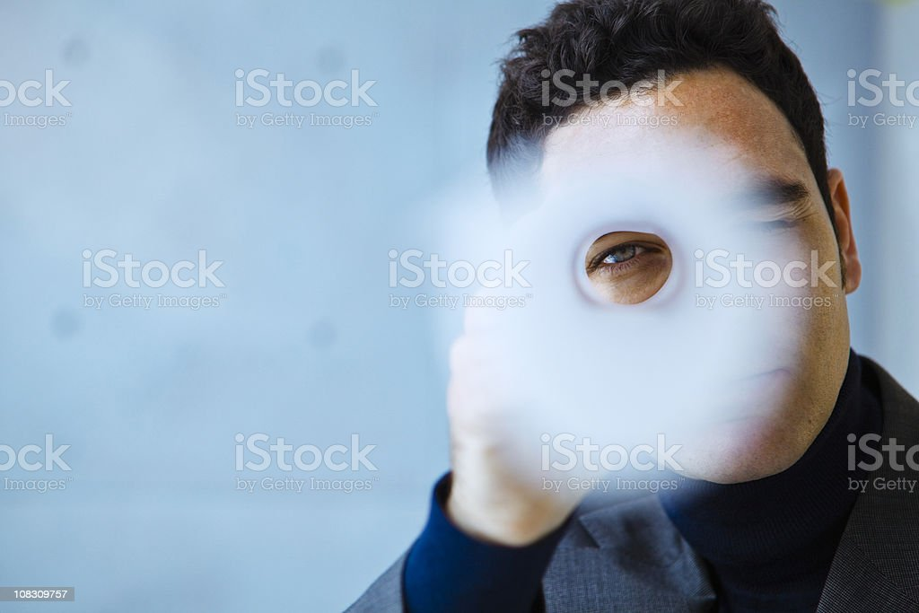 Architect looking through a roll of blueprints stock photo
