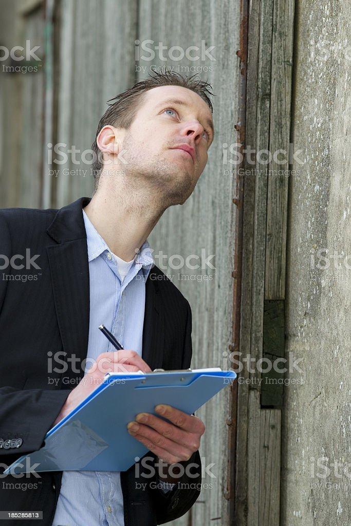 Architect making notes, old house stock photo