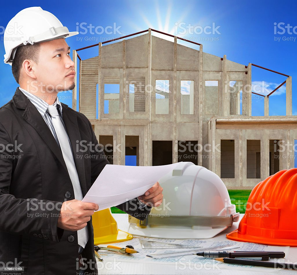 architect man and working plan in house construction site stock photo