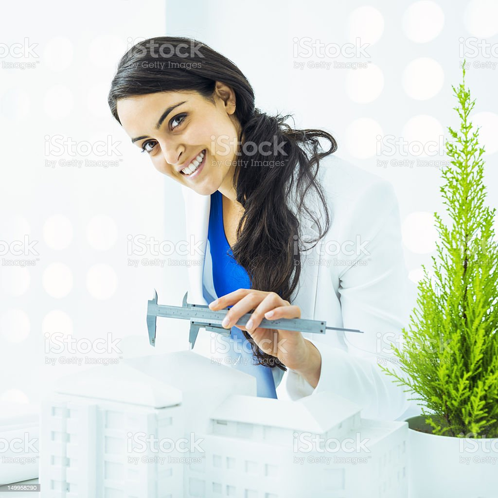 Architect measuring building model stock photo