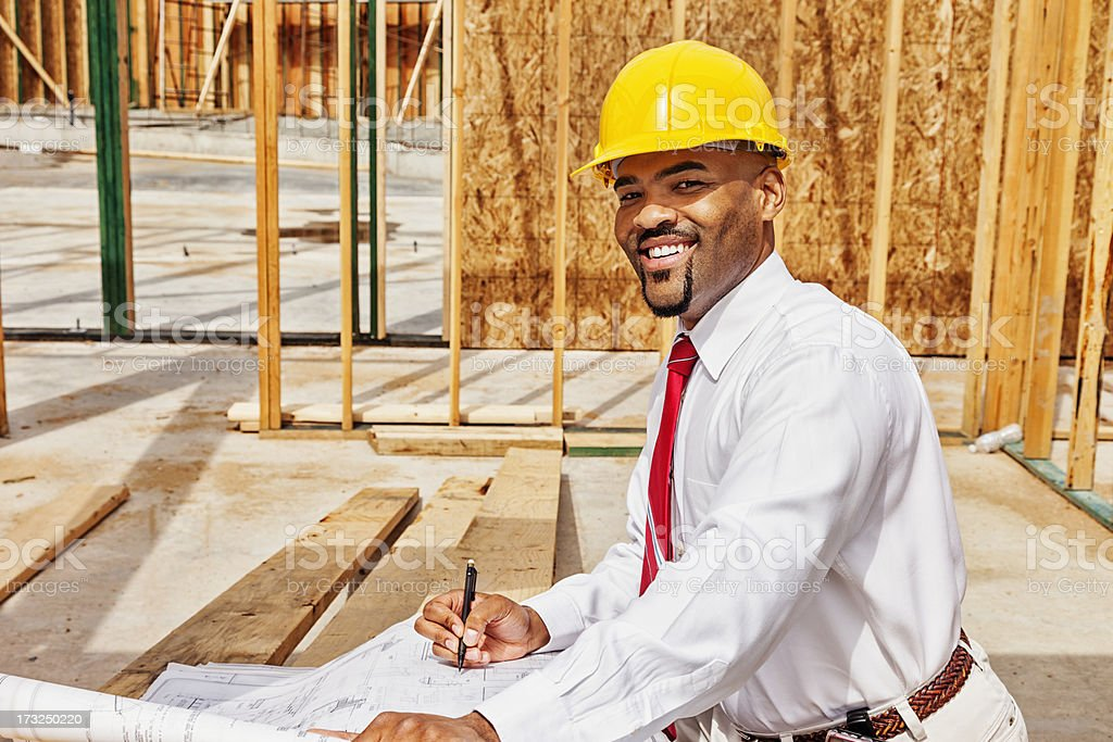 Architect on Site with Plans stock photo