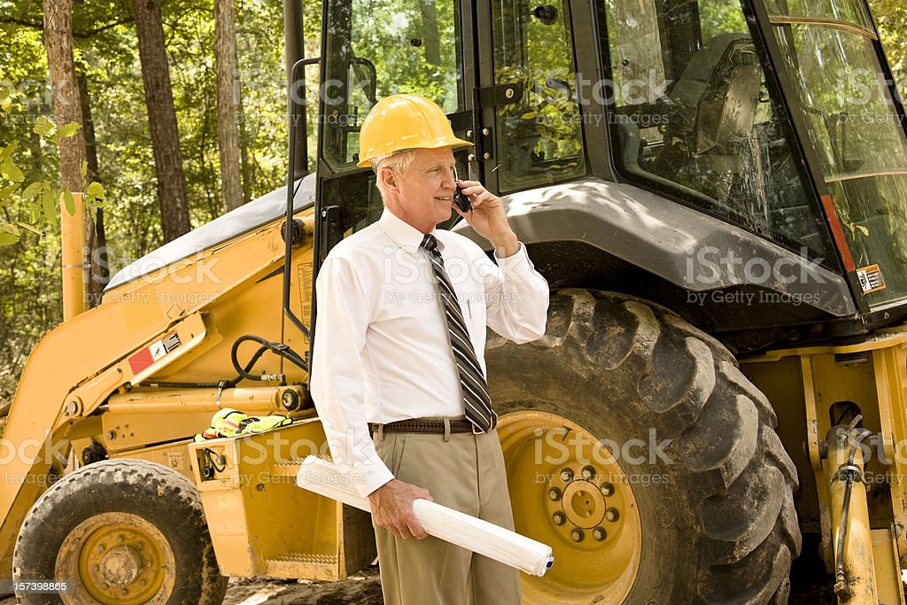 Architect or contractor on the construction site. Bulldozer. Developer. royalty-free stock photo