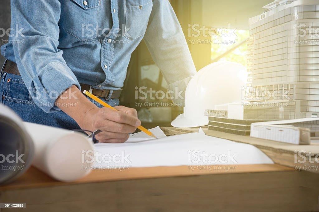 Architect or engineer working on blueprint stock photo