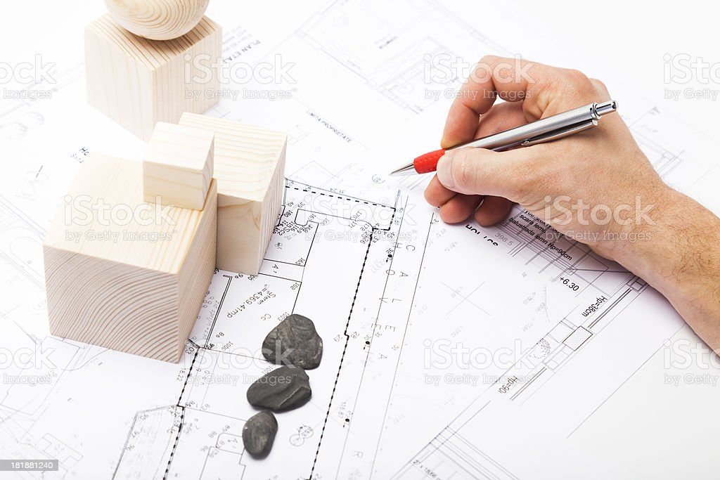 Architect Planning the City with Wooden Shapes. Scale Model. Blueprint. royalty-free stock photo