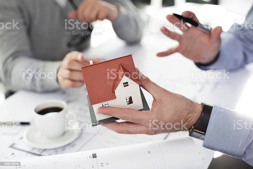 Architect presenting home project stock photo