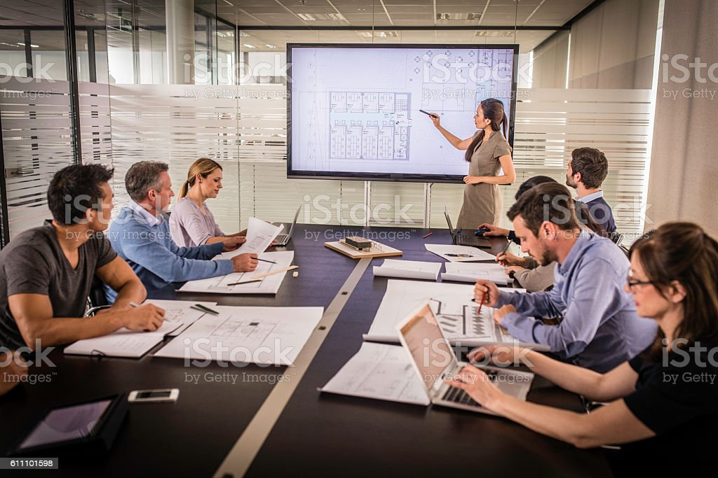 Architect presenting project plan stock photo