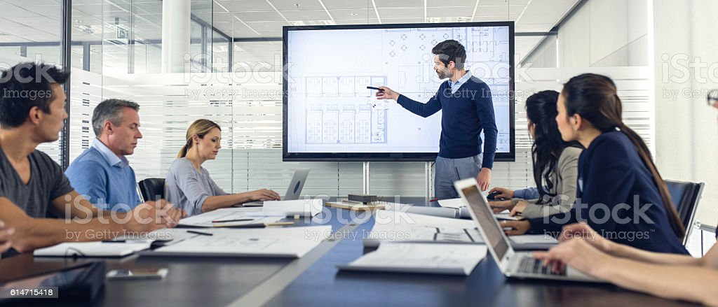 Architect presenting project to a group of managers stock photo