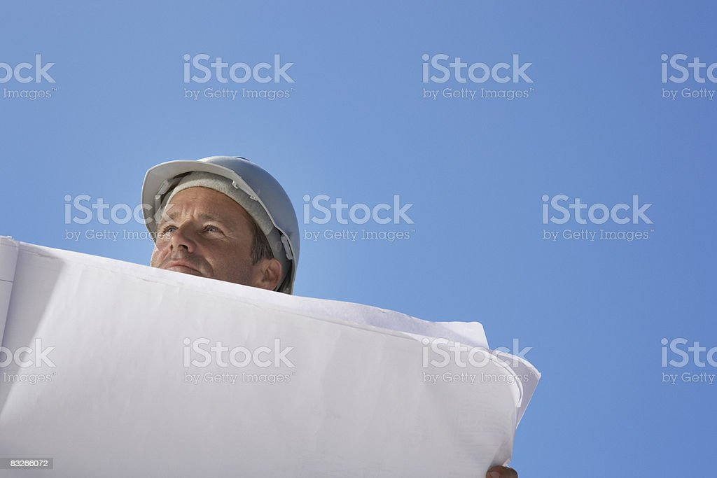 Architect reviewing blueprints royalty-free stock photo