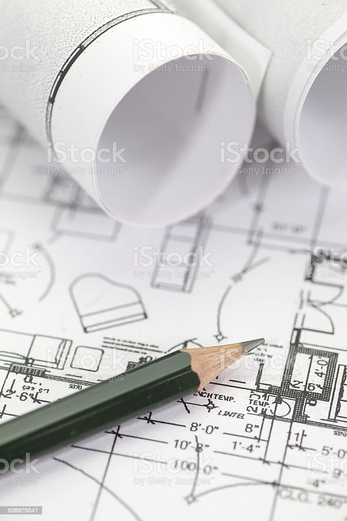 Architect rolls and plans construction project drawing royalty-free stock photo