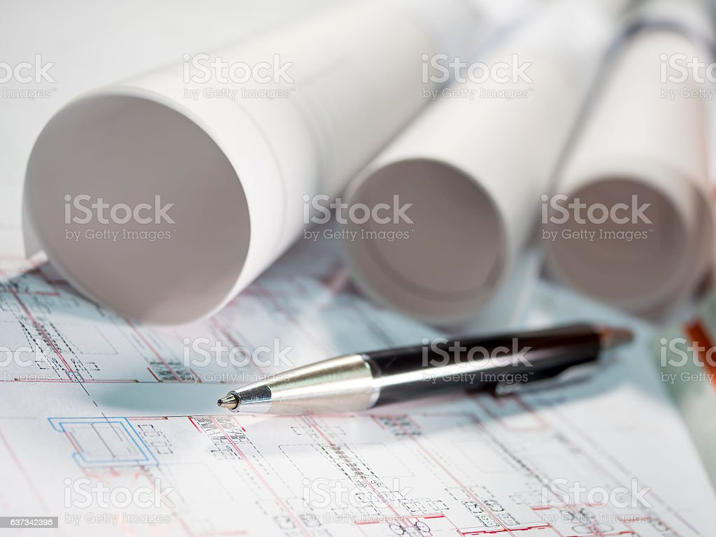 Architect rolls and plans, technical project drawing and pen 1 stock photo