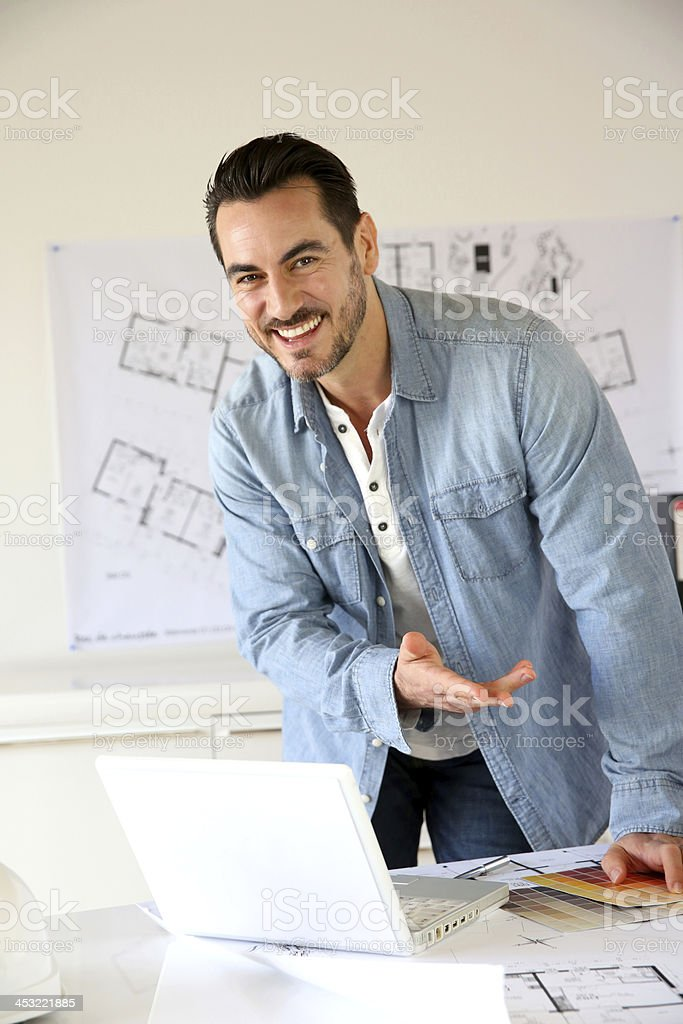 Architect standing in office talking at camera royalty-free stock photo