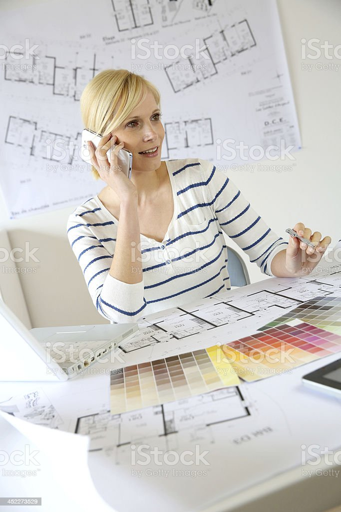 Architect talking on phone in office royalty-free stock photo
