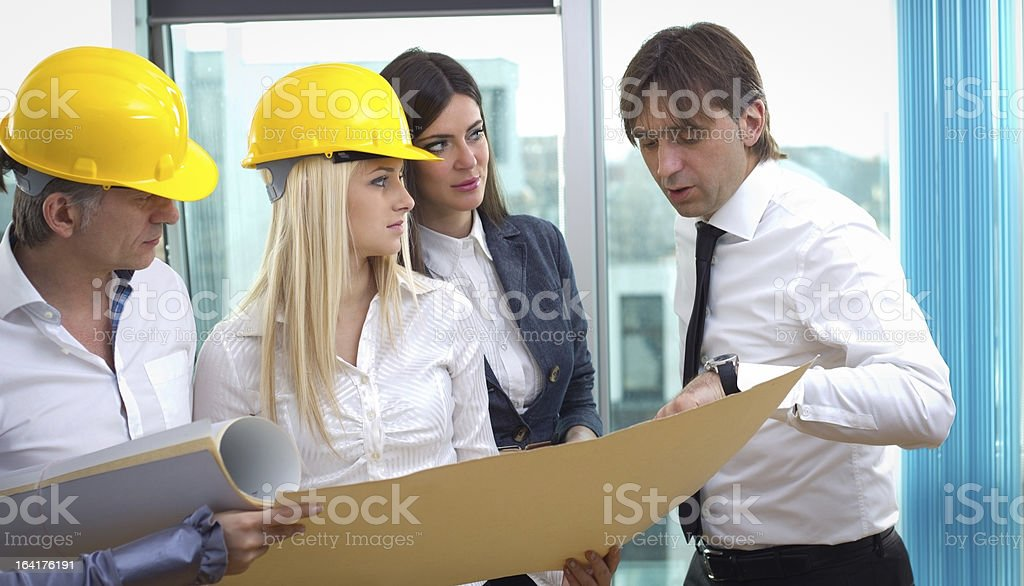 Architect talking to investor over the blueprints royalty-free stock photo