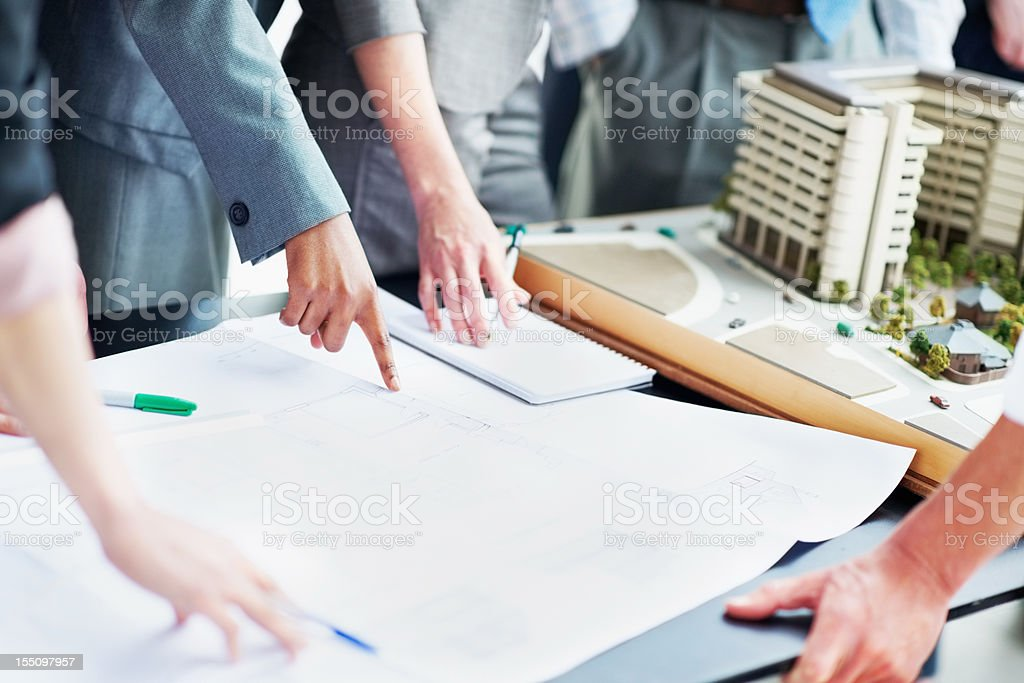 Architect team discussing blueprint royalty-free stock photo
