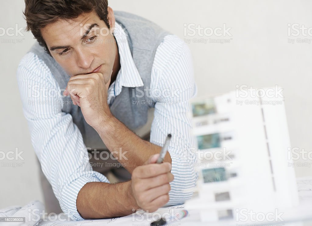 Architect thinking creatively in front of building model royalty-free stock photo