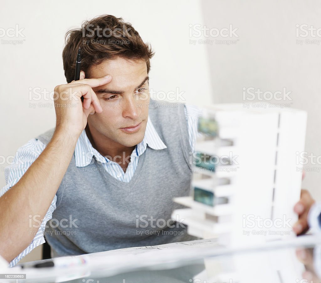 Architect thinking creativily in front of a model building royalty-free stock photo