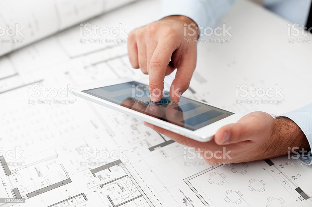 Architect using a digital tablet royalty-free stock photo