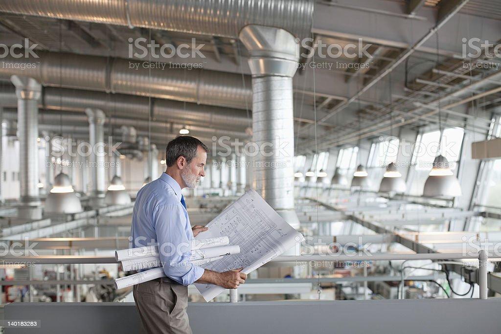 Architect viewing blueprints stock photo